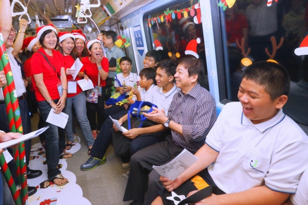 Pathlight Students & Families Treated to Inaugural Ride on Christmas-themed Train and Future of Us Exhibition